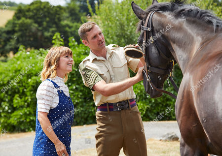 Zoe Henry joins Corporal of Horse Michael McGrath of the Household Cavalry in preparation for the parade .