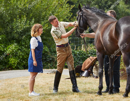 Zoe Henry joins  Corporal of Horse Michael McGrath of the Household Cavalry in preparation for the parade.