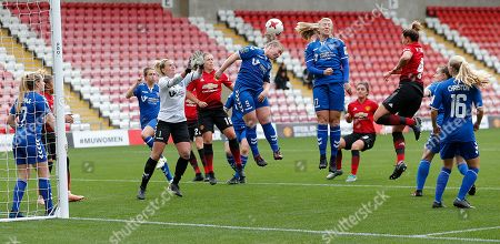 Sarah Wilson of Durham clears from Amy Turner of Manchester United Women