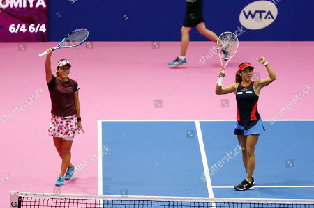 Japanese pair Miyu Kato (R) and Makoto Ninomiya (L) react to audience as they won the doubles final of the Toray Pan Pacific Open tennis tournament in Tokyo. Japanese pair defeated Czech pair of Andrea Hlavackova and Barbora Strycova in the final 6-4, 6-4.