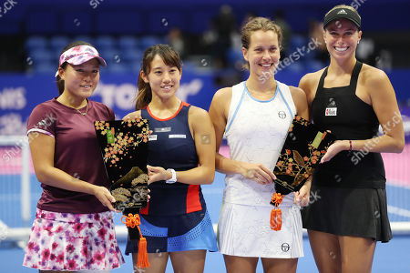 Japanese pair Miyu Kato (2nd L) and Makoto Ninomiya (L) smile as they won the doubles of the Toray Pan Pacific Open tennis tournament in Tokyo, while Czech pair of Andrea Hlavackova (R) and Barbora Strycova (2nd R) finished the runner up.