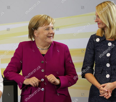 German Chancellor Angela Merkel (L) and the chief human resources manager of tire maker Continental, Ariane Reinhart (R), attend the  discussion meeting 'Sprechen wir ueber Europa' ('Let's talk about Europe') in Hannover, northern Germany, 24 September 2018. Merkel meets young adults  at the headquarters of Continental.
