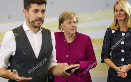 German Chancellor Angela Merkel (C) and the chief human resources manager of tire maker Continental, Ariane Reinhart (R), attend the  discussion meeting 'Sprechen wir ueber Europa' ('Let's talk about Europe') in Hannover, northern Germany, 24 September 2018. Merkel meets young adults  at the headquarters of Continental.