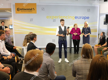 Stock Picture of German Chancellor Angela Merkel (C-L) and the chief human resources manager of tire maker Continental, Ariane Reinhart (R), attend the  discussion meeting 'Sprechen wir ueber Europa' ('Let's talk about Europe') in Hannover, northern Germany, 24 September 2018. Merkel meets young adults  at the headquarters of Continental.