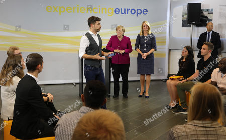 German Chancellor Angela Merkel (C-L) and the chief human resources manager of tire maker Continental, Ariane Reinhart (R), attend the  discussion meeting 'Sprechen wir ueber Europa' ('Let's talk about Europe') in Hannover, northern Germany, 24 September 2018. Merkel meets young adults  at the headquarters of Continental.