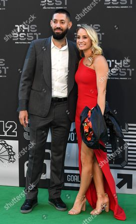 US former player Clint Dempsey and his wife Bethany arrive for the Best FIFA Football Awards 2018 in London, Great Britain, 24 September 2018. Man in center is unidentified.