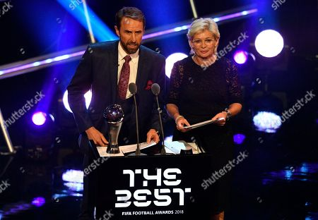 Stock Photo of England's national soccer coach Gareth Southgate (L) and German former coach Silvia Neid present The Best FIFA Women's Coach Award during the Best FIFA Football Awards 2018 in London, Great Britain, 24 September 2018.