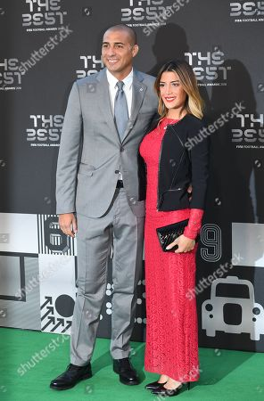 Former French international David Trezeguet (L) and an unidentified companion arrive for the Best FIFA Football Awards 2018 in London, Britain, 24 September 2018.