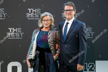 Football manager Fabio Capello and his wife Laura arrive for the ceremony of the Best FIFA Football Awards in the Royal Festival Hall in London, Britain