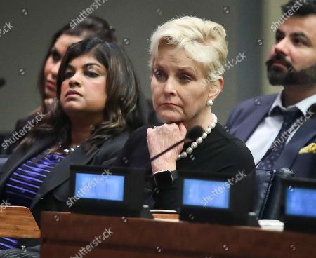 "Cindy McCain, second from right, co-chair of the McCain Institute's Human Trafficking Advisory Council, and trafficking survivor Rani Hong, second from left, listen after addressing the human rights conference, ""Stepping Up Action to End Forced Labour, Modern Slavery and Human Trafficking,"" during the United Nations General Assembly, at U.N. headquarters"