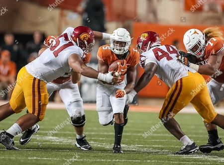 September15, Austin. TX..Texas Longhorns running back (5) Tre Watson hits the open hole created by teammates (72) Elijah Rodriguez and (77) Patrick Vahe during the game between the USC Trojans vs Texas Longhorns. Texas defeated USC 49-21 on at the Darrell K Royal - Texas Memorial Stadium, in Austin, Tx. (Mandatory Credit: Juan Lainez / MarinMedia.org / Cal Sport Media) (Complete photographer, and credit required)