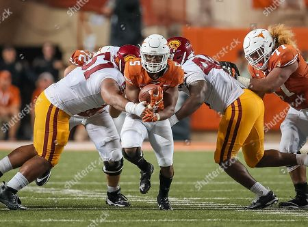 Stock Picture of September15, Austin. TX..Texas Longhorns running back (5) Tre Watson hits the open hole created by teammates (72) Elijah Rodriguez and (77) Patrick Vahe during the game between the USC Trojans vs Texas Longhorns. Texas defeated USC 49-21 on at the Darrell K Royal - Texas Memorial Stadium, in Austin, Tx. (Mandatory Credit: Juan Lainez / MarinMedia.org / Cal Sport Media) (Complete photographer, and credit required)