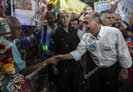 The candidate for the Presidency of Brazil for the Social Democratic Party of Brazil (PSDB) Geraldo Alckmin (R) participates in a campaign event in the northern area of the city of Rio de Janeiro, Brazil, 24 September 2018. General election in Brazil will take place on 07 October 2018.