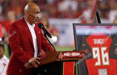 Former Tampa Bay Buccaneers head coach Tony Dungy speaks to the fans after being inducted in the team's Ring of Honor during halftime of an NFL football game against the Pittsburgh Steelers, in Tampa, Fla