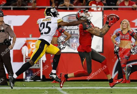 90c4b8a63ed Tampa Bay Buccaneers wide receiver Mike Evans (13) beats Pittsburgh Steelers  cornerback Artie Burns