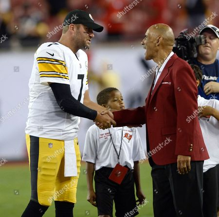 Pittsburgh Steelers quarterback Ben Roethlisberger (7) talks with former Tampa Bay Buccaneers coach Tony Dungy during warm ups prior to an NFL football game, in Tampa, Fla