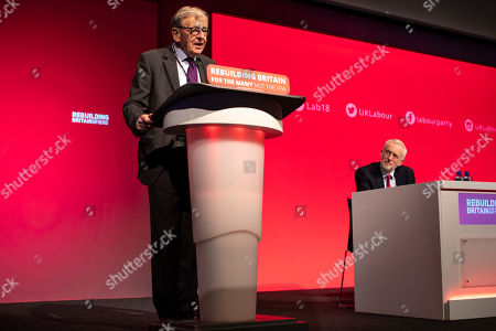 Lord Alf Dubs (L) speaks to Labour Conference as Labour Party Leader Jeremy Corbyn MP (R) watches.