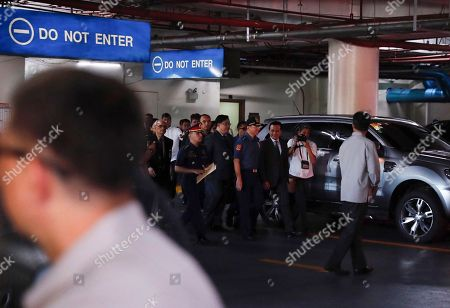 Philippine Senator Antonio Trillanes IV (3-R), a former military mutiny leader, prepares to leave the Senate on his way to post bail for an arrest warrant, in Pasay City, south of Manila, Philippines, 25 September 2018. A Makati City regional trial court issued an arrest warrant for Trillanes on 25 September, in relation to rebellion charges against him during the term of former President Gloria Macapagal-Arroyo. Philippine President Rodrigo Duterte, through a proclamation signed on 31 August, revoked the amnesty granted to Trillanes in relation to his involvement in military uprisings against former President Macapagal-Arroyo.