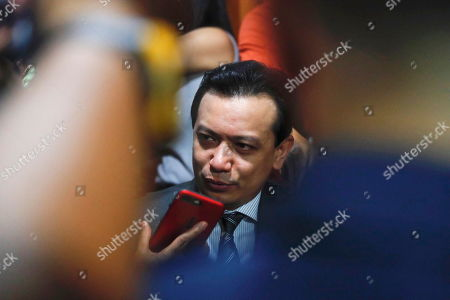 Philippine Senator Antonio Trillanes IV (C), a former military mutiny leader, is interviewed in a trial court building as he posts bail for an arrest warrant in Makati City, south of Manila, Philippines, 25 September 2018. A Makati City regional trial court issued an arrest warrant for Trillanes on 25 September, in relation to rebellion charges against him during the term of former President Gloria Macapagal-Arroyo. Philippine President Rodrigo Duterte, through a proclamation signed on 31 August, revoked the amnesty granted to Trillanes in relation to his involvement in military uprisings against former President Macapagal-Arroyo.