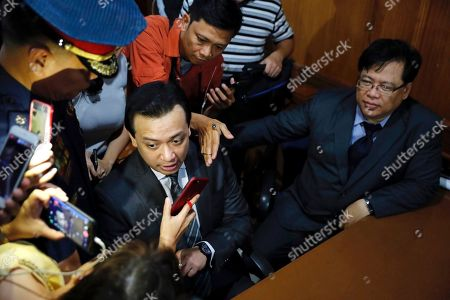 Philippine Senator Antonio Trillanes IV (C-L), a former military mutiny leader, is escorted in a trial court building as he posts bail for an arrest warrant in Makati City, south of Manila, Philippines, 25 September 2018. A Makati City regional trial court issued an arrest warrant for Trillanes on 25 September, in relation to rebellion charges against him during the term of former President Gloria Macapagal-Arroyo. Philippine President Rodrigo Duterte, through a proclamation signed on 31 August, revoked the amnesty granted to Trillanes in relation to his involvement in military uprisings against former President Macapagal-Arroyo.