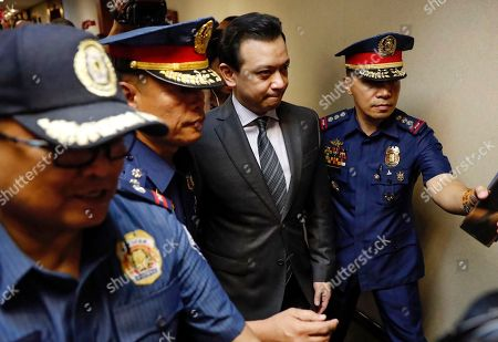 Philippine Senator Antonio Trillanes IV (2-R), a former military mutiny leader, is escorted in a trial court building as he posts bail for an arrest warrant in Makati City, south of Manila, Philippines, 25 September 2018. A Makati City regional trial court issued an arrest warrant for Trillanes on 25 September, in relation to rebellion charges against him during the term of former President Gloria Macapagal-Arroyo. Philippine President Rodrigo Duterte, through a proclamation signed on 31 August, revoked the amnesty granted to Trillanes in relation to his involvement in military uprisings against former President Macapagal-Arroyo.
