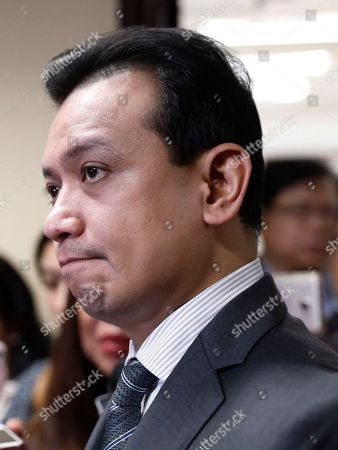 Philippine Senator Antonio Trillanes IV, returns to the Senate building and holds a press conference after posting bail for an arrest warrant, in Pasay City, south of Manila, Philippines 25 September 2018. A Makati City regional trial court issued an arrest warrant for Trillanes on 25 September, in relation to rebellion charges against him during the term of former President Gloria Macapagal-Arroyo. Philippine President Rodrigo Duterte, through a proclamation signed on 31 August, revoked the amnesty granted to Trillanes in relation to his involvement in military uprisings against former President Macapagal-Arroyo.