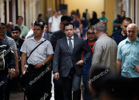 Philippine Senator Antonio Trillanes IV (C), returns to the Senate building to hold a press conference after posting bail for an arrest warrant, in Pasay City, south of Manila, Philippines 25 September 2018. A Makati City regional trial court issued an arrest warrant for Trillanes on 25 September, in relation to rebellion charges against him during the term of former President Gloria Macapagal-Arroyo. Philippine President Rodrigo Duterte, through a proclamation signed on 31 August, revoked the amnesty granted to Trillanes in relation to his involvement in military uprisings against former President Macapagal-Arroyo.