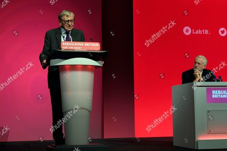 MP Baron Alfred Dubs (L), delivers a speech as he is watched by British Labour party leader Jeremy Corbyn (R) at the Labour Party Conference in Liverpool, Britain, 25 September 2018. The annual Labour Party Conference which will run from 23 September until Wednesday 26 September.