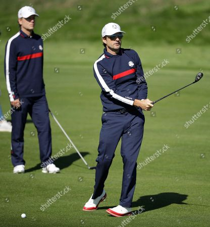 Stock Picture of Actor Greg Kinnear of the US, watches as Luke Wilson plays a shot from the 2nd fairway in the Ryder Cup Celebrity Challenge match at Le Golf National in Saint-Quentin-en-Yvelines, outside Paris, France, . The 42nd Ryder Cup will be held in France from Sept. 28-30, 2018 at Le Golf National