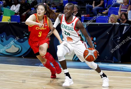 Senegal's Yacine Diop (R) in action against China's s Meng Li (L) during the basketball match between Senegal and China at the 2018 FIBA Women's Basketball World Cup in Santa Cruz de Tenerife, Canary Islands, Spain, 25 September 2018.