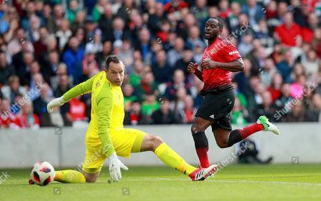Celtic & Ireland Legends vs Manchester United Legends. Manchester United's Louis Saha scores their second goal past goalkeeper David Forde of Celtic & Ireland Legends