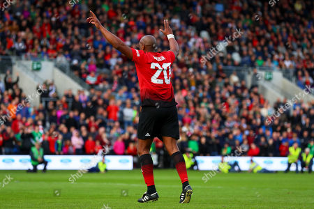 Celtic & Ireland Legends vs Manchester United Legends. Manchester United's Dion Dublin celebrates scoring a penalty to win the game