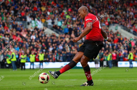 Celtic & Ireland Legends vs Manchester United Legends. Manchester United's Dion Dublin scores a penalty to win the game