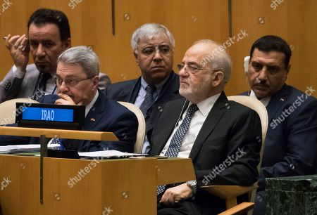 Iraq's Foreign Minister Ibrahim al-Jaafari listens as United Nations Secretary General Antonio Guterres addresses the 73rd session of the United Nations General Assembly, at U.N. headquarters