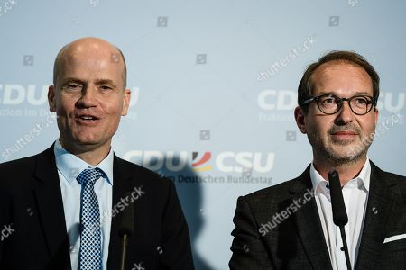 The newly elected parliamentary group leader of the CDU/CSU faction, Ralph Brinkhaus, speaks at a press conference next to next to the chairman of the Christian Social Union (CSU) Regional Group at the German parliament 'Bundestag' Alexander Dobrindt (R), following a joint meeting of the Christian Democratic Union (CDU) and Christian Social Union (CSU) parties' faction in Berlin, Germany, 25 September 2018. The joint CDU/CSU faction gathered to vote for their new chairman in an election which Brinkhaus won over the faction's long-time former chairman Volker Kauder.