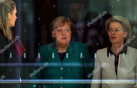 German Chancellor Angela Merkel (C) walks with Defense Minister Ursula von der Leyen (R) after voting in the elections for a new parliamentary leader of the joint Christian Democratic Union (CDU) and Christian Social Union (CSU) parties' faction, in Berlin, Germany, 25 September 2018. The joint CDU/CSU faction gathered to vote for their new chairman in an election which Brinkhaus won over the faction's long-time former chairman Volker Kauder.