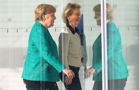 German Chancellor Angela Merkel (L) walks with Defense Minister Ursula von der Leyen (C) after voting in the elections for a new parliamentary leader of the joint Christian Democratic Union (CDU) and Christian Social Union (CSU) parties' faction, in Berlin, Germany, 25 September 2018. The joint CDU/CSU faction gathered to vote for their new chairman in an election which Brinkhaus won over the faction's long-time former chairman Volker Kauder.
