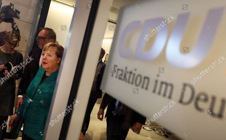 German Chancellor Angela Merkel (L) leaves after voting in the elections for a new parliamentary leader of the joint Christian Democratic Union (CDU) and Christian Social Union (CSU) parties' faction, in Berlin, Germany, 25 September 2018. The joint CDU/CSU faction gathered to vote for their new chairman in an election which Brinkhaus won over the faction's long-time former chairman Volker Kauder.