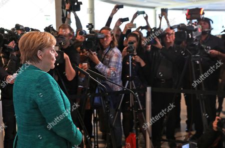 German Chancellor Angela Merkel (L) speaks to the media after voting in the elections for a new parliamentary leader of the joint Christian Democratic Union (CDU) and Christian Social Union (CSU) parties' faction, in Berlin, Germany, 25 September 2018. The joint CDU/CSU faction gathered to vote for their new chairman in an election which Brinkhaus won over the faction's long-time former chairman Volker Kauder.