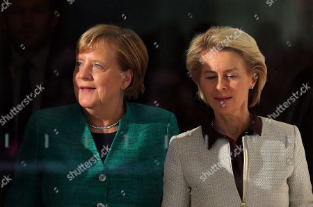 German Chancellor Angela Merkel (L) walks with Defense Minister Ursula von der Leyen (R) after voting in the elections for a new parliamentary leader of the joint Christian Democratic Union (CDU) and Christian Social Union (CSU) parties' faction, in Berlin, Germany, 25 September 2018. The joint CDU/CSU faction gathered to vote for their new chairman in an election which Brinkhaus won over the faction's long-time former chairman Volker Kauder.