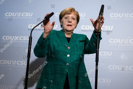 German Chancellor Angela Merkel delivers a statement to the media outside the CDU/CSU faction rooms after the election of Ralph Brinkhaus as the new parliamentary group leader at a joint meeting of the Christian Democratic Union (CDU) and Christian Social Union (CSU) parties' faction, in Berlin, Germany, 25 September 2018. Ralph Brinkhaus succeeds the faction's long-time former parliamentary group leader Volker Kauder.