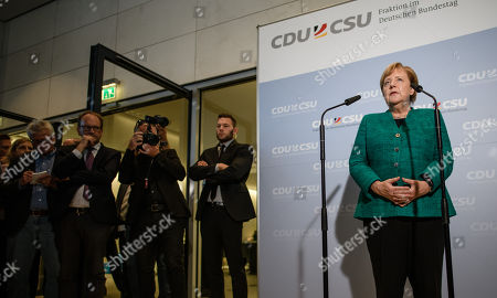 German Chancellor Angela Merkel (R) delivers a statement to the media outside the CDU/CSU faction rooms after the election of Ralph Brinkhaus as the new parliamentary group leader at a joint meeting of the Christian Democratic Union (CDU) and Christian Social Union (CSU) parties' faction, in Berlin, Germany, 25 September 2018. Ralph Brinkhaus succeeds the faction's long-time former parliamentary group leader Volker Kauder.