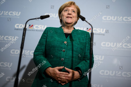 German Chancellor Angela Merkel has her hands folded as she delivers a statement to the media outside the CDU/CSU faction rooms after the election of Ralph Brinkhaus as the new parliamentary group leader at a joint meeting of the Christian Democratic Union (CDU) and Christian Social Union (CSU) parties' faction, in Berlin, Germany, 25 September 2018. Ralph Brinkhaus succeeds the faction's long-time former parliamentary group leader Volker Kauder.