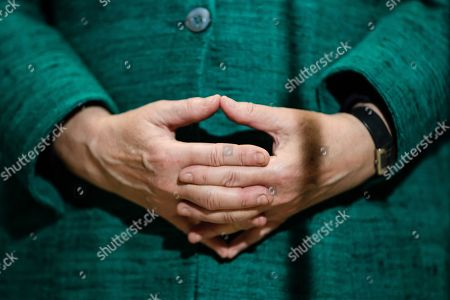 The hands of German Chancellor Angela Merkel are folded as she delivers a statement to the media outside the CDU/CSU faction rooms after the election of Ralph Brinkhaus as the new parliamentary group leader at a joint meeting of the Christian Democratic Union (CDU) and Christian Social Union (CSU) parties' faction, in Berlin, Germany, 25 September 2018. Ralph Brinkhaus succeeds the faction's long-time former parliamentary group leader Volker Kauder.
