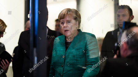 The hands of German Chancellor Angela Merkel arrives to deliver a statement to the media outside the CDU/CSU faction rooms after the election of Ralph Brinkhaus as the new parliamentary group leader at a joint meeting of the Christian Democratic Union (CDU) and Christian Social Union (CSU) parties' faction, in Berlin, Germany, 25 September 2018. Ralph Brinkhaus succeeds the faction's long-time former parliamentary group leader Volker Kauder.
