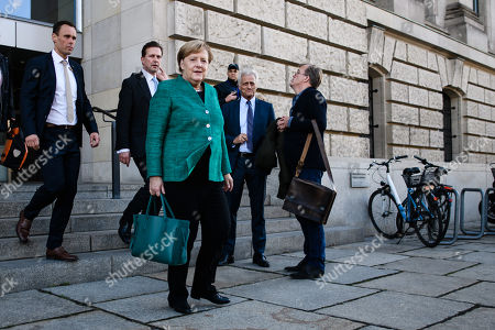 German Chancellor Angela Merkel (C) leaves  after the election of Ralph Brinkhaus as the new parliamentary group leader at a joint meeting of the Christian Democratic Union (CDU) and Christian Social Union (CSU) parties' faction, in Berlin, Germany, 25 September 2018. Ralph Brinkhaus succeeds the faction's long-time former parliamentary group leader Volker Kauder.