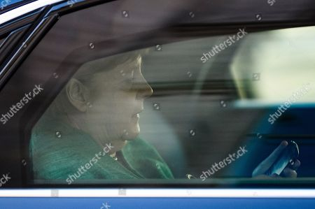 German Chancellor Angela Merkel sits in the car and looks on her phone as she eaves  after the election of Ralph Brinkhaus as the new parliamentary group leader at a joint meeting of the Christian Democratic Union (CDU) and Christian Social Union (CSU) parties' faction, in Berlin, Germany, 25 September 2018. Ralph Brinkhaus succeeds the faction's long-time former parliamentary group leader Volker Kauder.