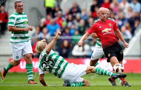 Celtic & Ireland Legends vs Manchester United Legends. Celtic & Ireland's Johan Mjallby and Nicky Butt of Manchester United