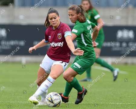 Claire Rafferty of West Ham Women shielding the ball from Annie Heatherson Yeovil Town Ladies