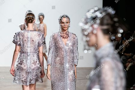 Stock Photo of Models present creations from the Spring/Summer 2019 Women's collections by Japanese designer Kunihiko Morinaga for Anrealage during the Paris Fashion Week, in Paris, France, 25 September 2018. The presentation of the Women's collections runs from 24 September to 02 October.